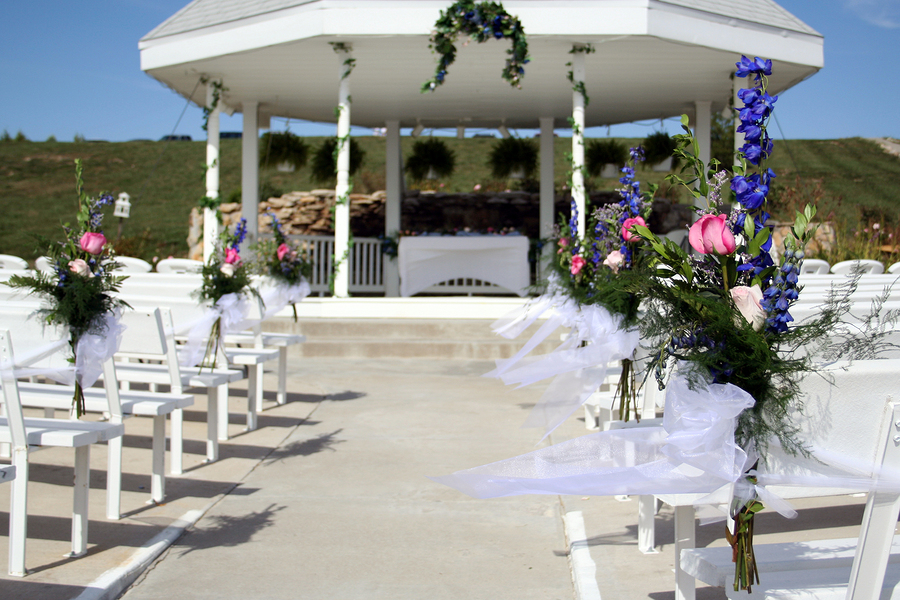 Flower arrangements on the pews at a wedding